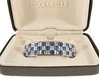 Grillz i sølv med blå og hvide sten