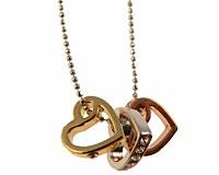 Se mere om Halsk�de med tre hjerter i guld s�lv og kobber farve i web-butikken