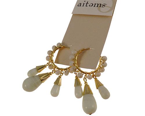 Se mere om aitems øreringe i hvid og guld i web-butikken