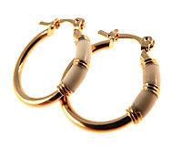 Se mere om Donna Bella øreringe med hvid farve og 18 karat guld i web-butikken