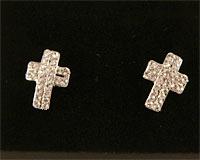 Se mere om Øreringe med kors belagt med hvide sten i web-butikken
