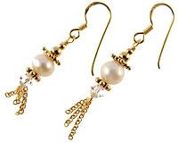 Se mere om Forgyldte sterling sølv øreringe med perle og klar sten i web-butikken