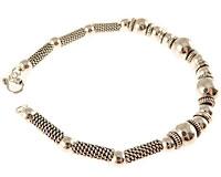 Se mere om Sølvarmbånd med sølvkugler i flot udformning i web-butikken
