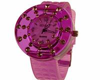Se mere om Gennemsigtigt gummi ur i lilla farve med klare sten i web-butikken