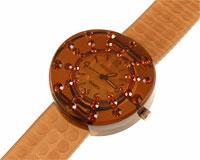 Se mere om Gennemsigtigt gummi ur i brunlig farve med brunlige sten i web-butikken