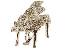 Se mere om Broche med flygel i sølvfarve i web-butikken