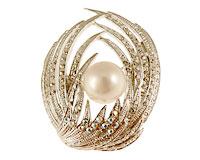 Se mere om Broche belagt med små klare sten og hvid perle i web-butikken