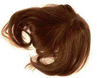 Se mere om 100% ægte pandehår i brun farve med 2 clips i web-butikken