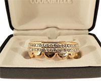 Se mere om Grillz i guld med to rækker hvide sten i web-butikken