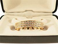 Se mere om Grillz med i guld med tre rækker hvide sten i web-butikken