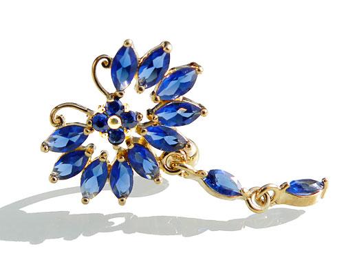 Se mere om navle piercing i guld med sommerfugl med hale med blå sten i web-butikken
