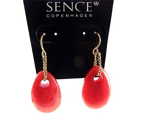 Se mere om røde øreringe fra sence copenhagen i web-butikken