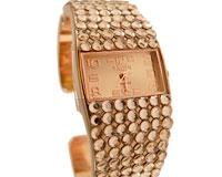 Se mere om Smykkeur i guldfarve med rem der virker som armbånd i web-butikken