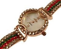 Se mere om Smykkeur i guld med guld, røde og grøn sten i web-butikken
