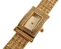 Se mere om OSCAR smykkeur i guld med med klare sten i web-butikken