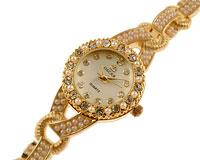Se mere om OSCAR smykkeur i guld og hvide perle i web-butikken