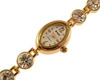 Se mere om EMU smykkeur i guld med store hvide sten i web-butikken