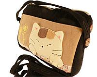 Se mere om Lille håndtaske fra japanske Kokocat i sort og brunlig farve i web-butikken