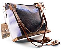Se mere om Taske af ægte læder i brun og lys lilla farve.  i web-butikken